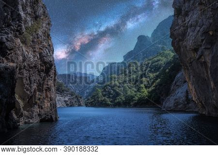 Milky Way Over The Beautiful Mountain Canyon And Blue Sea At Night In Summer. Colorful Landscape Wit