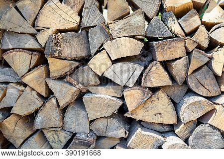 Close-up And Selective Focus Of Stack Of Logs For Fireplace And Barbecue. Concept Of Preparation For