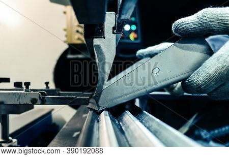 The Bending Machine Operator Bends The Part. Workflow Of Bending Metal On A Machine