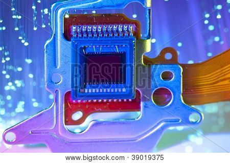 CCD sensor on a card of digital camera with fiber optical background