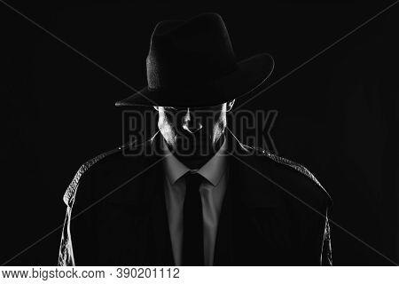Old Fashioned Detective In Hat On Dark Background, Black And White Effect