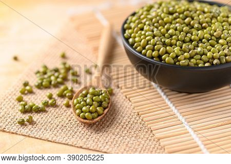 Mung Bean In A Bowl And Spoon On Wooden Background