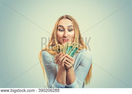 Greedy Girl With Currency American Dollars Money. Blond Woman In White Shirt Holding Heap Of Money A