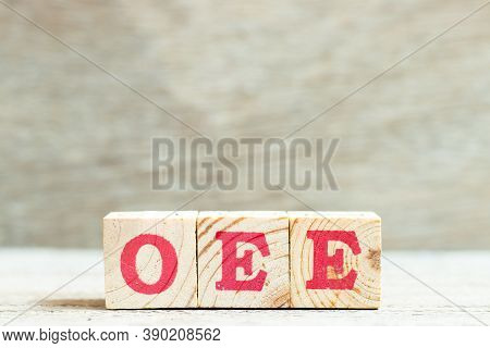 Alphabet Letter Block In Word Oee (abbreviation Of Overall Equipment Effectiveness) On Wood Backgrou