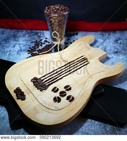 Wooden Guitar Board With Coffee And Coffee Beans In A Glas
