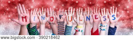Children Hands Building Word Mindfulness, Red Christmas Background