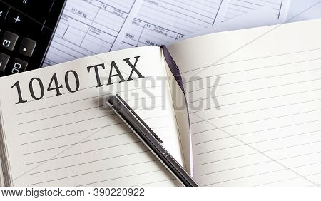 Notebook With Toolls And Notes About 1040 Tax .