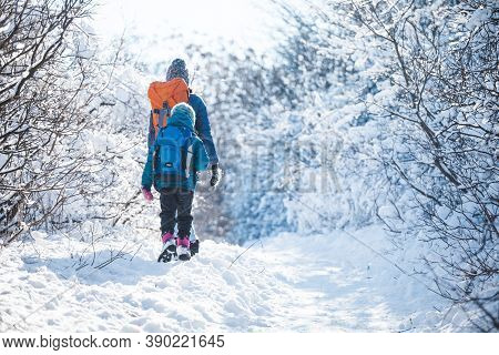 Woman With A Child On A Winter Hike In The Mountains, The Boy Travels With Mother In The Cold Season