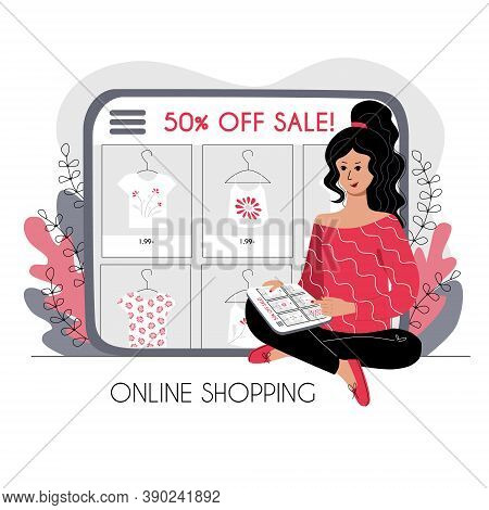 Online Shopping Concept. The Girl Is Sitting And Choosing Clothes On The Store Website On The Tablet