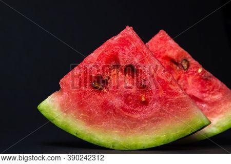Watermelon On A Black Background. Cut Off A Slice Of Watermelon. Red Ripe Watermelon