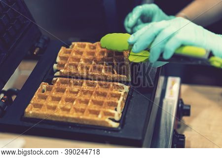 Waffle Iron In The Kitchen. Preparing Homemade Waffles, Pouring A Dough. Preparing Of Homemade Waffl