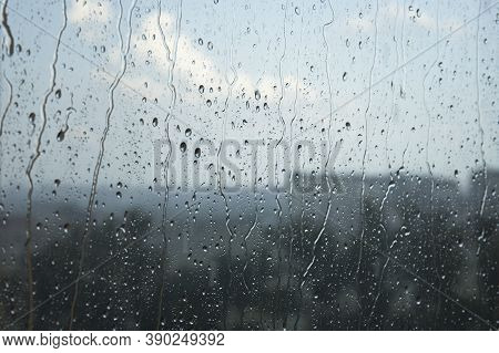 Rainy Weather Landcsape View Through A Window With Rain Drops On The Glass. Stormy Autumn Weather Im