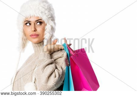 Happy Woman Holding Shopping Bags With Copyspace . Winter Sales. Isolated Over White Background