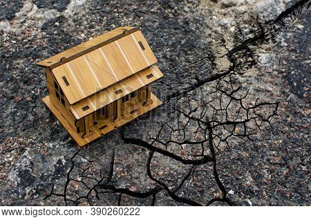 Lonely Building On The Road In The Cracks Of An Earthquake. Concept Of Risk Insurance In The Event O