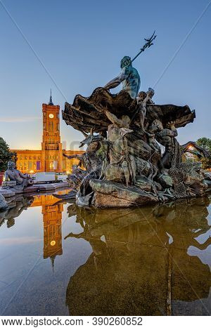 The Neptune Fountain At The Alexanderplatz In Berlin At Dawn With The Townhall In The Back