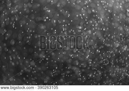 Snow Or Rain Bokeh Texture Overlay On Black Background.