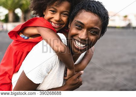 Happy African Family Having Fun On The Beach During Summer Holidays - Afro Mother And Daughter Enjoy