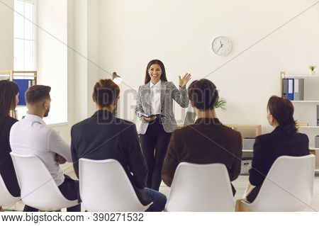 Smiling Company Manager Or Team Leader Greeting Workers Or Interns In Corporate Meeting