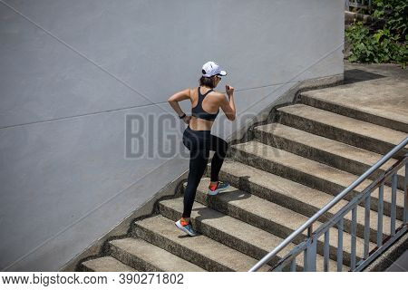 Asian Women Running And Jogging During Outdoor On City Run