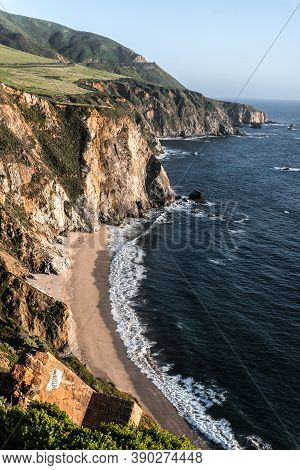Rocky Steep Ocean Coast. Scenic Green Hills And Stormy Waves Under. Pacific Coast Highway, Californi