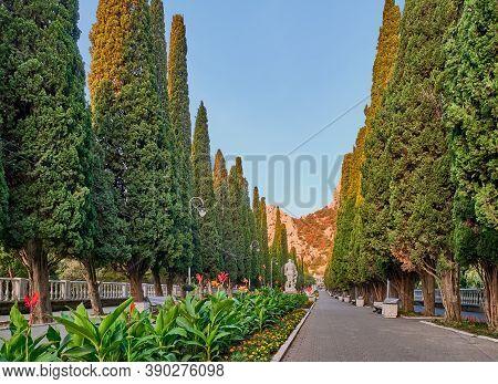 Cypress Alley In Town Simeiz, Big Yalta, South Coast Of Crimea. Apollo Alley, Lenin Avenue. The Text