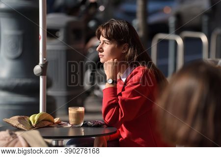 Vilnius, Lithuania - October 07: Unidentified People In Vilnius Old Town Outdoor Cafe On October 07,