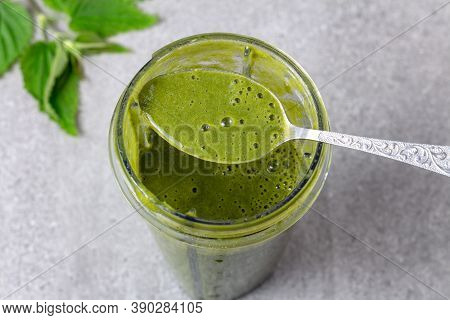 Blended Green Smoothie With Nettles And Fruits. Cocktail Contains Natural Chlorophyll