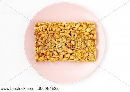 A Bar Of Peanut Brittle On The Plate. Food Energy Mockup. Background Image For Sweet Snacks. Top Vie