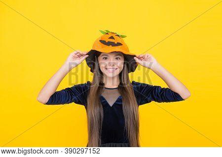 Halloween Girl In Pumpkin Hat. Happy Childhood. Teen Child In Gourd Hat. Smiling Kid Wearing Squash