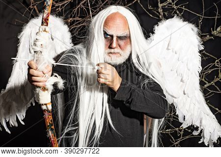 Bearded Man With Angel Wings. Senior Man Posing With Angel Wings. Tree Spirit And Fantasy Concept. A