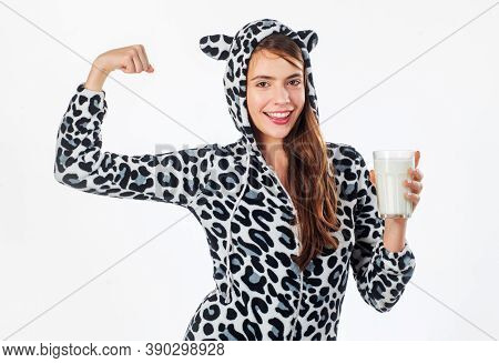 Milk Looking To Party. Pretty Girl In Spotted Cow Design Costume Holding Glass Of Dairy Food. Young