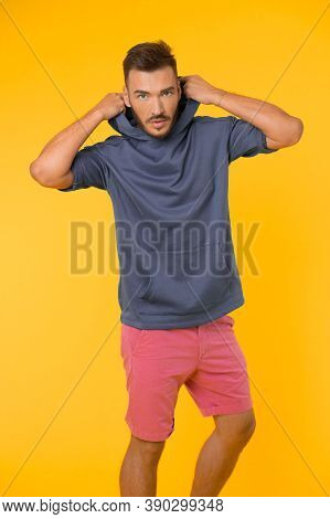 Energetic Concept. Energetic Man In Casual Wear On Yellow Background. Fashion For Energetic You. Ene