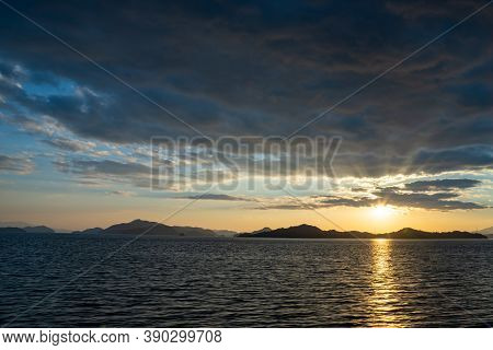 Sunset Time In The Seto Inland Sea, Japan. Golden Reflection On Ocean Surface