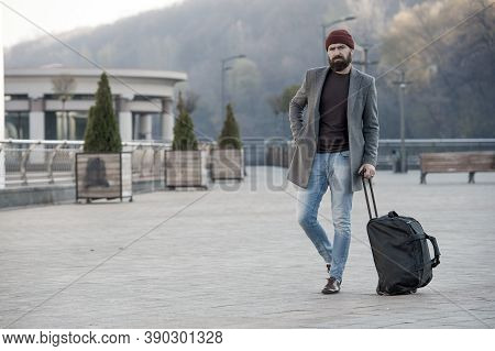 Hipster Ready Enjoy Travel. Looking For Accommodation. Man Bearded Hipster Travel With Big Luggage B