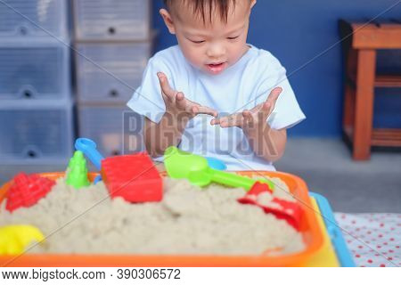 Cute Curious Asian 2 - 3 Years Old Toddler Boy Playing With Kinetic Sand In Sandbox At Home / Nurser
