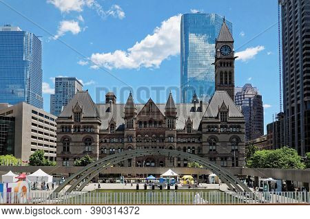 Toronto, Canada - 06 27 2016: View Across The Fountain On Nathan Phillips Square With Old City Hall