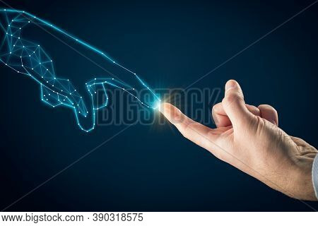 Artificial Intelligence (ai) And Industry 4.0 Concept. Human Hand And Graphics Hand Symbolizing Pcb