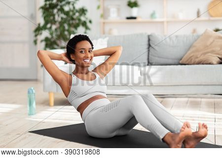 Full Length Portrait Of Beautiful African American Woman Keeping Fit At Home. Sporty Black Lady Exer