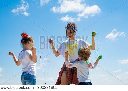 Kids Celebrate Holi With Color, Happy Holi. Children With Colored Powder And Color Dust Splash