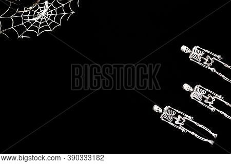 Halloween Decoration Card With Skeletons For Celebration Design. Black Background. Flat Lay. Place F