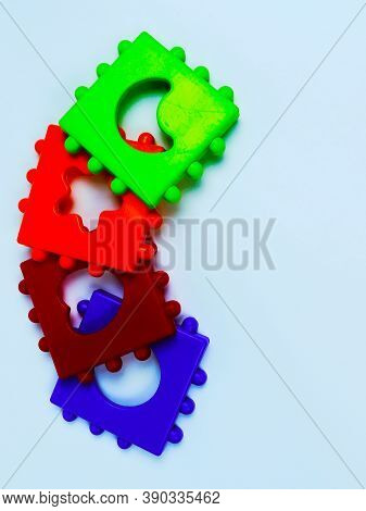Isolated Multicolored Details Of A Child Sorter On A White Background. Puzzle. Sorter. The View From