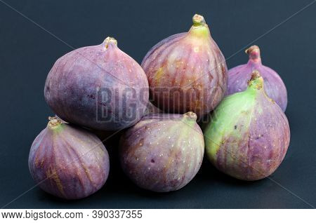 A Heap Of Ripe Figs, Exotic Fruits On A Dark Background