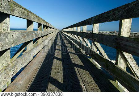 Wooden Bridge To Wave Breaker In Westhaven Cove In Westport, Grays Harbor, Washington