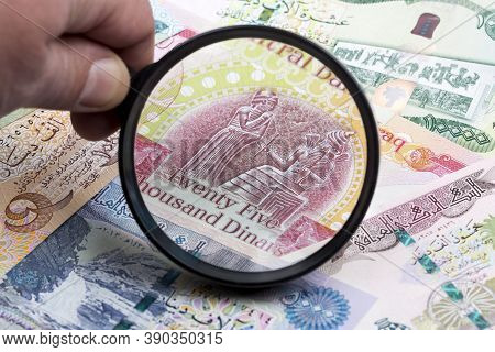 Iraqi Dinar In A Magnifying Glass A Business Background