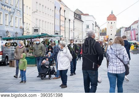 Neuoetting,germany, October 18 2020: People Wearing Facemasks Under New Guidelines For Protrection F