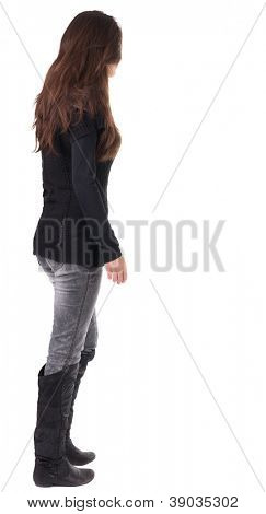 back view of walking  woman  in  in jeans and sweater. beautiful brunette girl in motion.  backside view of person.  Rear view people collection. Isolated over white background.