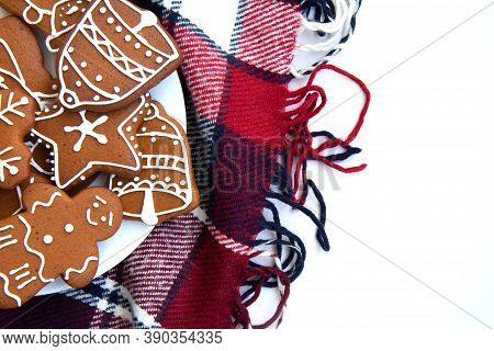 Tasty Homemade Christmas Gingerbread Cookie Of Various Shapes With Sugar Glaze On A Red Plaid Blanke