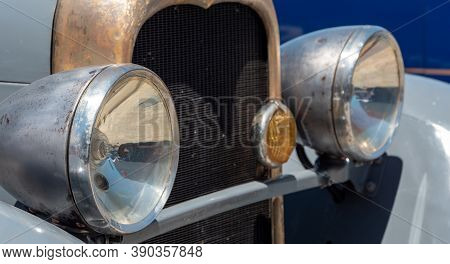 A Close Up Of Antique Car Headlamps.
