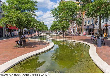 Hoogeveen, Netherlands - June 17, 2019: Meandering Cascade Canal In The Main Street Of Hoogeveen, Ne