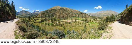 Andes Mountains Near Ausangate, Corn Field And Road Near Cusco Or Cuzco Town In Peru